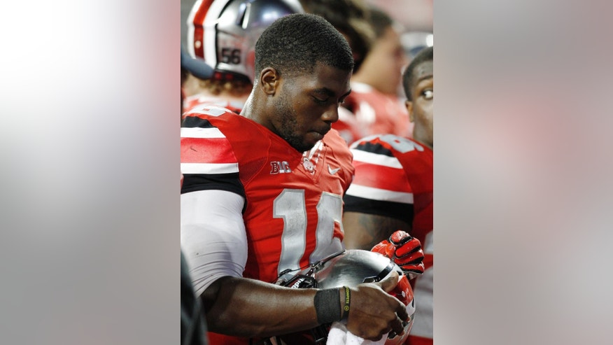 Ohio State quarterback J.T. Barrett leaves the field after their loss to Virginia Tech in an NCAA college football game Saturday, Sept. 6, 2014, in Columbus, Ohio. Virginia Tech beat Ohio State 35-21. (AP Photo/Paul Vernon)