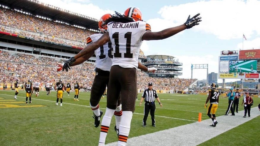 Cleveland Browns wide receiver Travis Benjamin (11) celebrates with wide receiver Taylor Gabriel (18) after making a touchdown catch in the fourth quarter of the NFL football game against the Cleveland Browns on Sunday, Sept. 7, 2014 in Pittsburgh. (AP Photo/Gene Puskar)