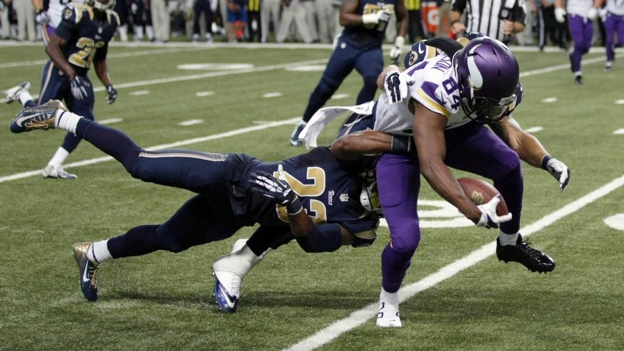 Minnesota Vikings wide receiver Cordarrelle Patterson, right, is slowed by St. Louis Rams free safety Rodney McLeod, left, after catching a pass for a 13-yard gain during the second quarter an NFL football game Sunday, Sept. 7, 2014, in St. Louis. (AP Photo/Tom Gannam)