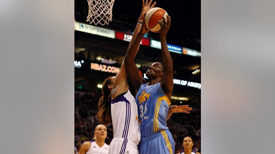 Chicago Sky center Sylvia Fowles (34) has her shot blocked by Phoenix Mercury center Brittney Griner in the second half of Game 1 of the WNBA basketball finals, Sunday, Sept. 7, 2014, in Phoenix. The Mercury defeated the Sky 83-62. (AP Photo/Rick Scuteri)