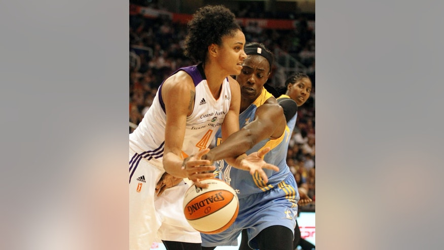 Chicago Sky center Sylvia Fowles (34) and Phoenix Mercury forward Candice Dupree (4) battle for the ball in the second half of Game 1 of the WNBA basketball finals, Sunday, Sept. 7, 2014, in Phoenix. The Mercury defeated the Sky 83-62. (AP Photo/Rick Scuteri)