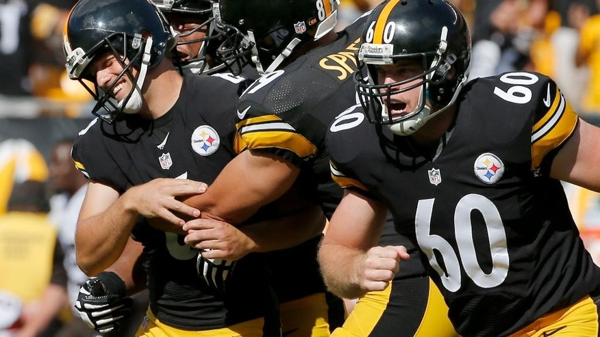 Pittsburgh Steelers kicker Shaun Suisham (6), left, is congratulated by teammates agter hitting a 41-yard field goal as time ran out in the fourth quarter of the NFL football game against the Cleveland Browns  on Sunday, Sept. 7, 2014 in Pittsburgh. The Steelers won 30-27. (AP Photo/Gene J. Puskar)