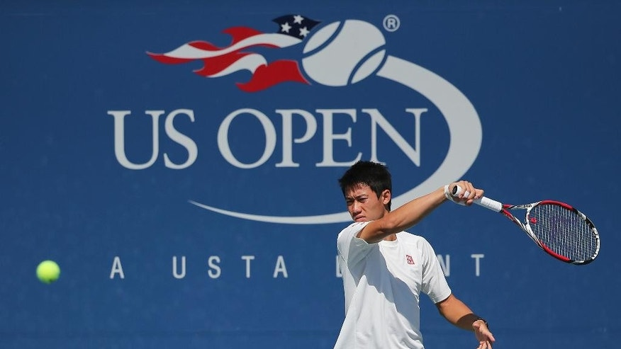Kei Nishikori, of Japan, returns a shot during a practice session in preparation for Monday's final match against Marin Cilic, of Croatia, at the 2014 U.S. Open tennis tournament, Sunday, Sept. 7, 2014, in New York. (AP Photo/Mike Groll)