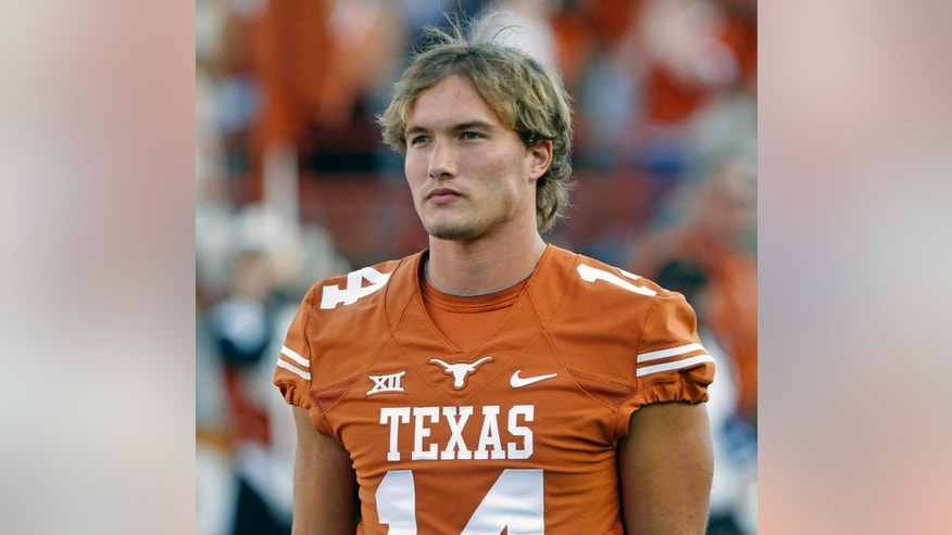 Texas quarterback David Ash comes onto the field before an NCAA college football game against BYU in Austin, Texas, Saturday,  Sept. 6, 2014.  (AP Photo/Michael Thomas)