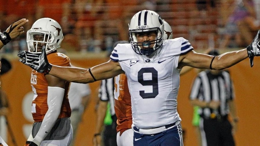 BYU receiver Jordan Leslie (9) celebrates a pass reception against Texas during the third quarter of an NCAA college football game in Austin, Texas, Saturday,  Sept. 6, 2014.  (AP Photo/Michael Thomas)