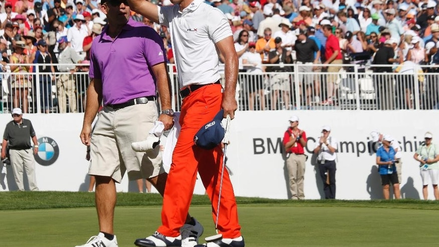 Billy Horschel acknowledges the crowd after putting out on the 18th hole to claim victory in the BMW Championship golf tournament in Cherry Hills Village, Colo., Sunday, Sept. 7, 2014. (AP Photo/David Zalubowski)