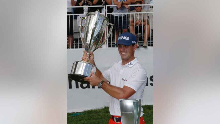 Billy Horschel holds up the trophy for winning the BMW Championship golf tournament in Cherry Hills Village, Colo., on Sunday, Sept. 7, 2014. (AP Photo/David Zalubowski)