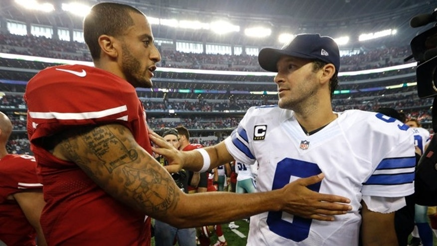 Colin Kaepernick and Tony Romo after their NFL football game, Sunday, Sept. 7, 2014, in Arlington, Texas.
