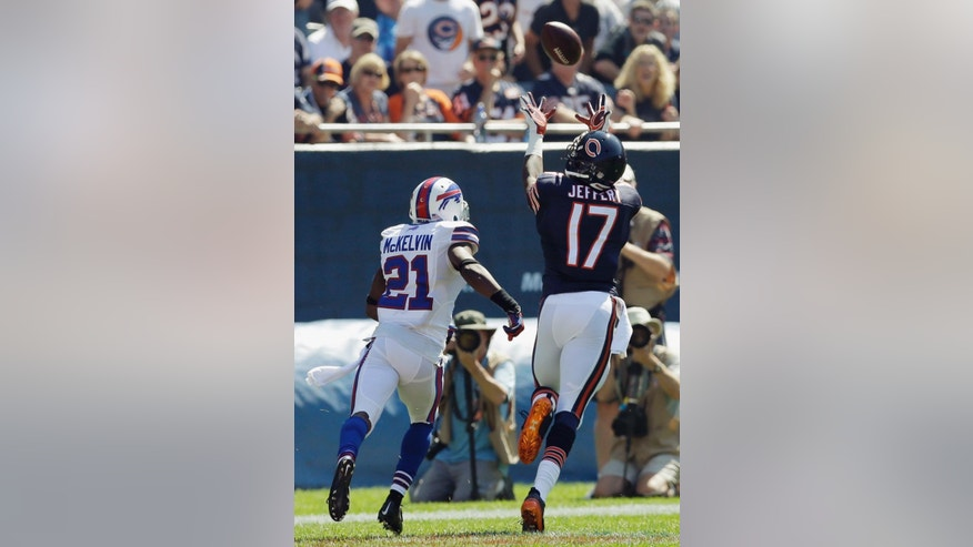Chicago Bears wide receiver Alshon Jeffery (17) makes a reception on a pass by quarterback Jay Cutler with Buffalo Bills cornerback Leodis McKelvin (21) covering during the first half of an NFL football game Sunday, Sept. 7, 2014, in Chicago. (AP Photo/Nam Y. Huh)