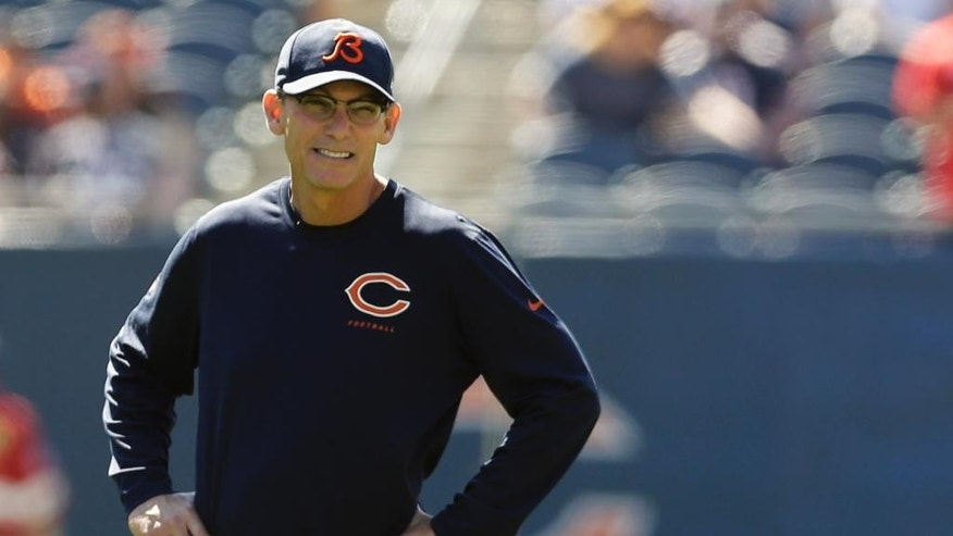 Chicago Bears head coach Marc Trestman watches as players warm up before an NFL football game against the Buffalo Bills Sunday, Sept. 7, 2014, in Chicago. (AP Photo/Nam Y. Huh)