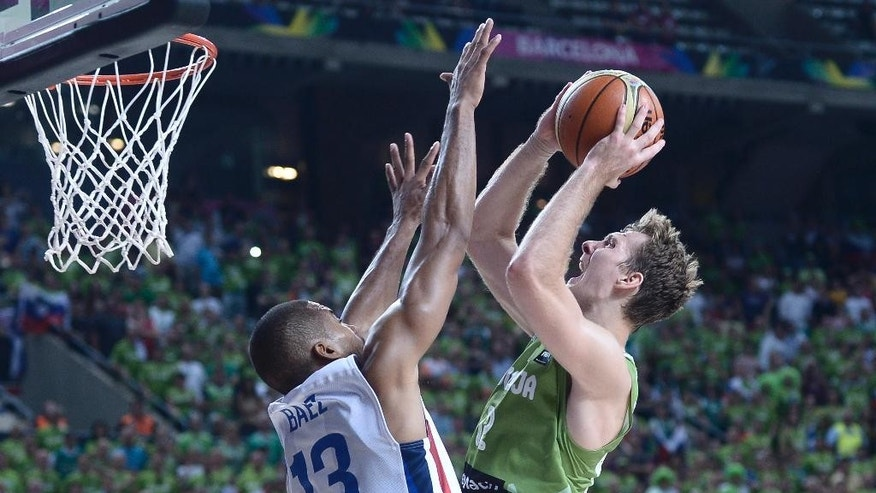 Dominican Republic  Eulis Baez, left, vies for the ball against Slovenia's Zoran Dragic, second right, during Basketball World Cup Round of 16 match between Dominican Republic and Slovenia at the Palau Sant Jordi in Barcelona, Spain, Saturday, Sept. 6, 2014. The 2014 Basketball World Cup competition will take place in various cities in Spain from Aug. 30 through to Sept. 14. (AP Photo/Manu Fernandez)