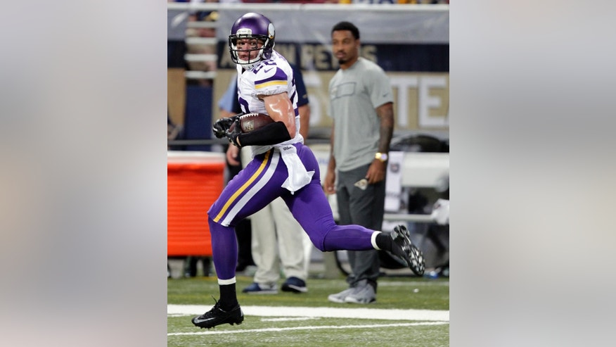 Minnesota Vikings free safety Harrison Smith looks back as he runs with an intercepted pass 81-yards for a touchdown during the fourth quarter an NFL football game against the St. Louis Rams Sunday, Sept. 7, 2014, in St. Louis. (AP Photo/Tom Gannam)