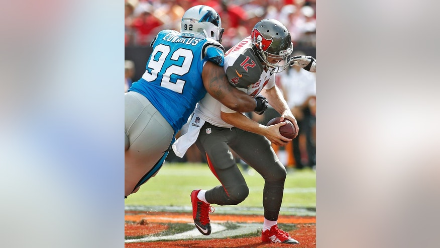 Carolina Panthers defensive tackle Dwan Edwards (92) sacks Tampa Bay Buccaneers quarterback Josh McCown (12) during the first quarter of an NFL football game Sunday, Sept. 7, 2014, in Tampa, Fla. (AP Photo/Brian Blanco)