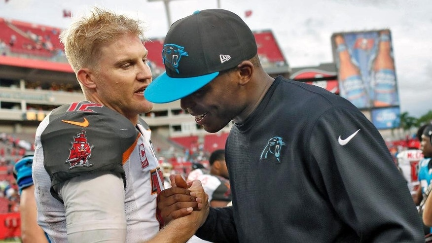 Tampa Bay Buccaneers quarterback Josh McCown (12), left, shakes hands with Carolina Panthers quarterback Cam Newton after the Panthers defeated the Buccaneers 20-14 in an NFL football game Sunday, Sept. 7, 2014, in Tampa, Fla. (AP Photo/Brian Blanco)