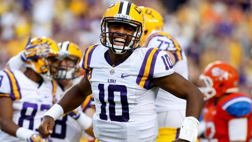 LSU quarterback Anthony Jennings (10) celebrates after scoring on a 28-yard touchdown during the first half of an NCAA college football game against Sam Houston State in Baton Rouge, La., Saturday, Sept. 6, 2014. (AP Photo/Jonathan Bachman)