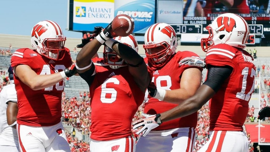 Wisconsin's Corey Clement (6) celebrates his touchdown run during the second half of an NCAA college football game against Western Illinois Saturday, Sept. 6, 2014, in Madison, Wis. Wisconsin won 37-3. (AP Photo/Morry Gash)