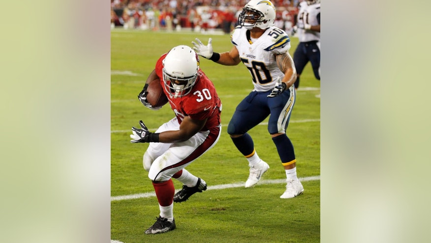 Arizona Cardinals running back Stepfan Taylor (30) pulls in a touchdown pass as San Diego Chargers inside linebacker Manti Te'o (50) stands near during the second half of an NFL football game, Monday, Sept. 8, 2014, in Glendale, Ariz. (AP Photo/Ross D. Franklin)