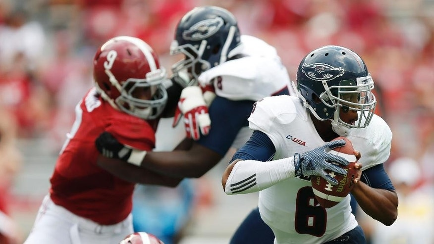 Florida Atlantic quarterback Greg Hankerson (6) slips through Alabama defense and looks to pass during the second half of an NCAA college football game  Saturday, Sept. 6, 2014, in Tuscaloosa, Ala. (AP Photo/Brynn Anderson)
