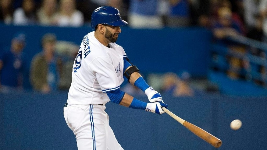 Toronto Blue Jays Jose Bautista connects for a three run double during seventh inning action against the Chicago Cubs in Toronto on Tuesday, Sept.9, 2014. (AP Photo/The Canadian Press, Frank Gunn)