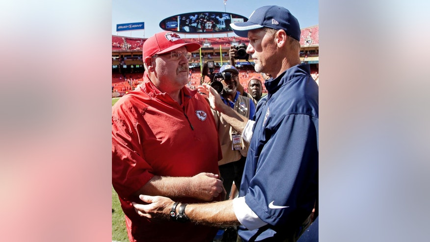 Kansas City Chiefs head coach Andy Reid and Tennessee Titans head coach  Ken Whisenhunt talk after their NFL football game Sunday, Sept. 7, 2014, in Kansas City, Mo. The Titans won 26-10. (AP Photo/Charlie Riedel)
