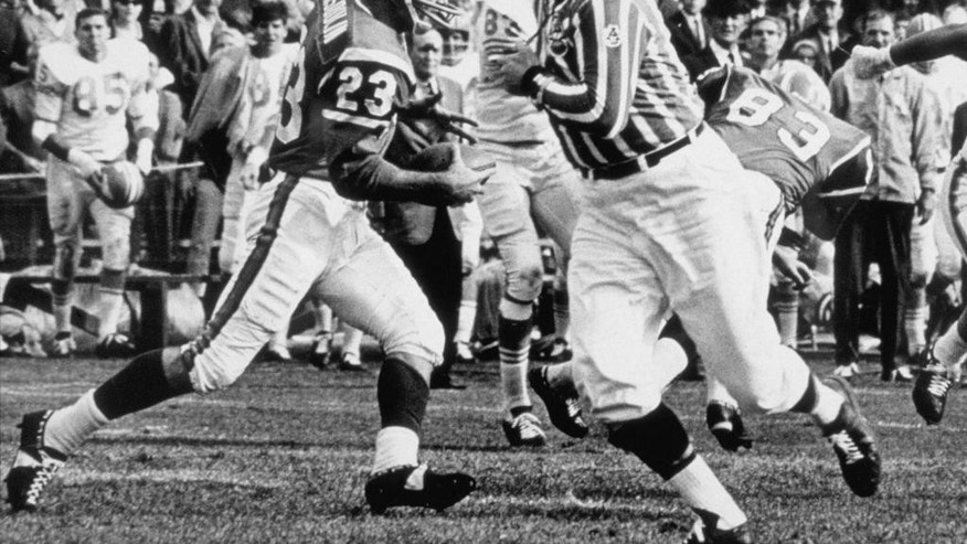 """This undated file photo provided by the Denver Broncos shows Austin """"Goose"""" Gonsoulin (23) running with the football. Gonsoulin, the former Pro Bowl safety for the Denver Broncos and a member of the team's Ring of Fame, died Monday, Sept. 8. 2014, in Beaumont, Texas. He was 76.  (AP Photo/Denver Broncos, File)"""