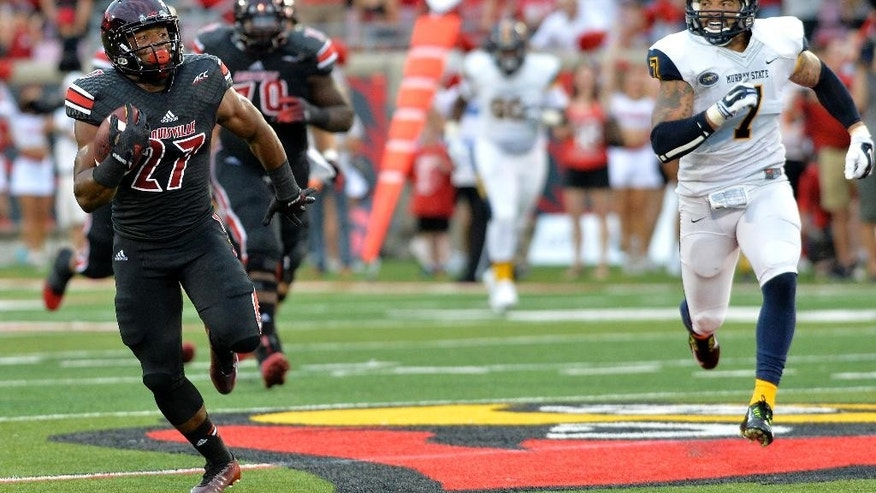 CORRECTS ID TO L.J. SCOTT, NOT GREG WILLARD - Louisville's L.J. Scott, left, outruns the pursuit of Murray State's Anthony Hayes during the second quarter of their NCAA college football game Saturday, Sep. 6, 2014 at Papa John's Cardinal Stadium in Louisville, Ky. (AP Photo/Timothy D. Easley)