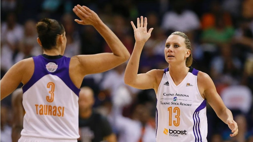 Phoenix Mercury forward Penny Taylor (13) high fives Diana Taurasi (3) during the second half of  Game 2 of the WNBA basketball finals against the Chicago Sky, Tuesday, Sept. 9, 2014, in Phoenix. (AP Photo/Matt York)