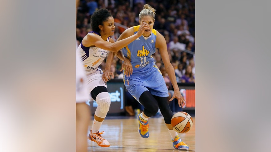 Chicago Sky forward Elena Delle Donne (11) drives against Phoenix Mercury forward Candice Dupree during the second half of  Game 2 of the WNBA basketball finals, Tuesday, Sept. 9, 2014, in Phoenix. (AP Photo/Matt York)