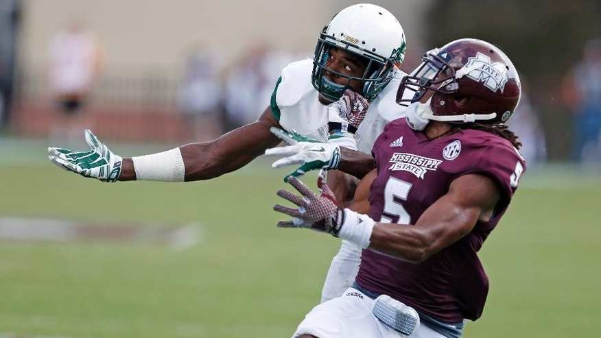 Mississippi State defensive back Jamerson Love (5) and UAB wide receiver Nyiakki Height (8) jockey for position to catch a pass in the second half of an NCAA college football game at Davis Wade Stadium in Starkville, Miss., Saturday, Sept. 6, 2014. The ball fell incomplete. Mississippi State won 47-34. (AP Photo/Rogelio V. Solis)