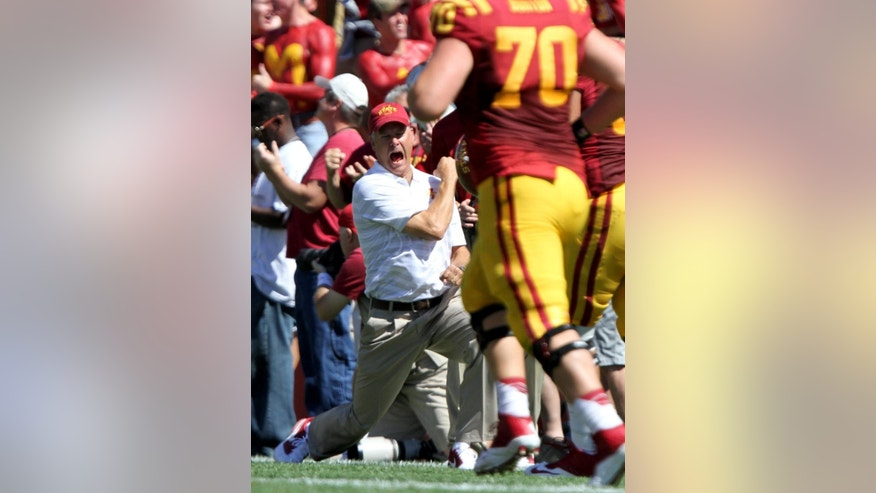 Iowa State head coach Paul Rhoads celebrates after Iowa State wide receiver Jarvis West returned a punt for a touchdown during the first half of an NCAA college football game against Kansas State, Saturday, Sept. 6, 2014, in Ames, Iowa. (AP Photo/Justin Hayworth)