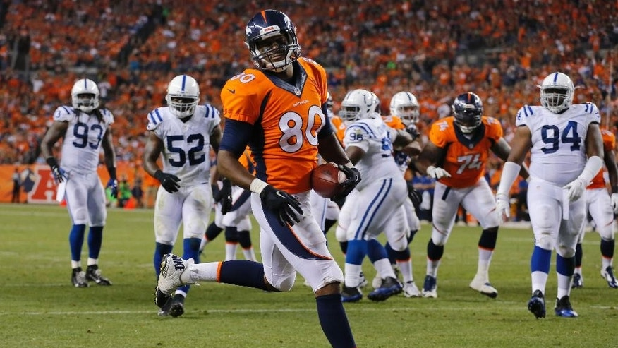 Denver Broncos tight end Julius Thomas (80) scores a touchdown against the Indianapolis Colts during the first half of an NFL football game, Sunday, Sept. 7, 2014, in Denver. (AP Photo/Jack Dempsey)