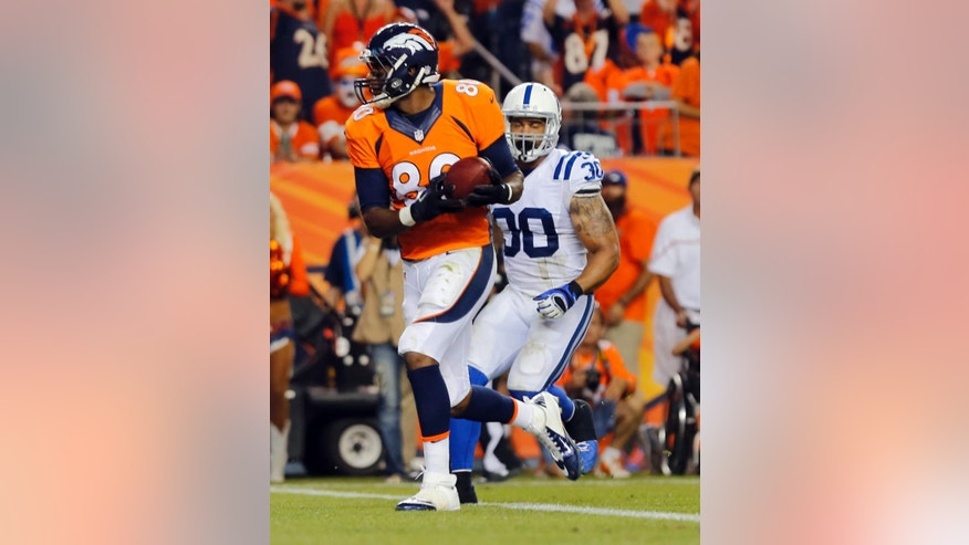 Denver Broncos tight end Julius Thomas (80) scores as Indianapolis Colts strong safety LaRon Landry (30) defends during the first half of an NFL football game, Sunday, Sept. 7, 2014, in Denver. (AP Photo/Joe Mahoney)
