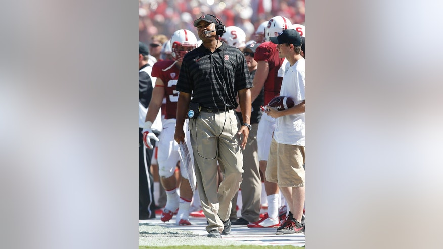 Stanford head coach David Shaw reacts after Stanford fumbled in the final seconds against Southern California during the second half of an NCAA college football game on Saturday, Sept. 6, 2014, in Stanford, Calif. Southern California won 13-10. (AP Photo/Tony Avelar)