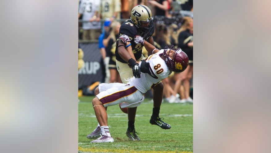 Central Michigan's Anthony Rice is hit by Purdue's Frankie Williams after going high for an errant  pass during an NCAA college football game Saturday, Sept.  6, 2014, at Ross-Ade Stadium in West Lafayette, Ind. Williams was called for targeting and was disqualified for the rest of the game in Purdue's 38-17 loss . (AP Photo/Journal & Courier, Michael Heinz)