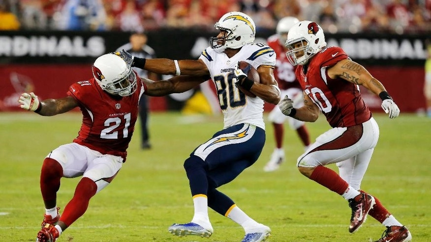 San Diego Chargers wide receiver Malcom Floyd (80) is pursued by Arizona Cardinals inside linebacker Larry Foote (50) and Patrick Peterson (21) during the second half of an NFL football game, Monday, Sept. 8, 2014, in Glendale, Ariz. (AP Photo/Rick Scuteri)