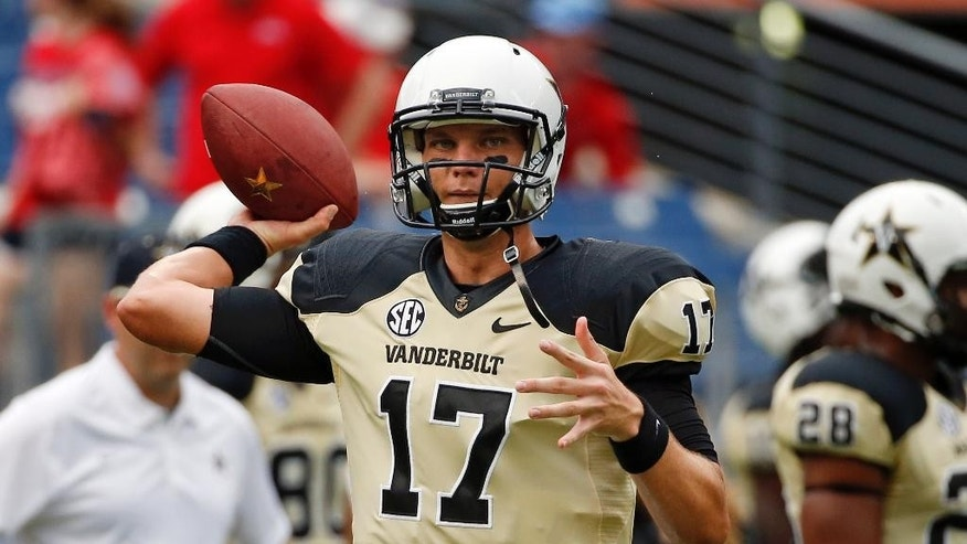 Vanderbilt quarterback Stephen Rivers (17) warms up before an NCAA college football game against Mississippi, Saturday, Sept. 6, 2014, in Nashville, Tenn. (AP Photo/Mark Humphrey)