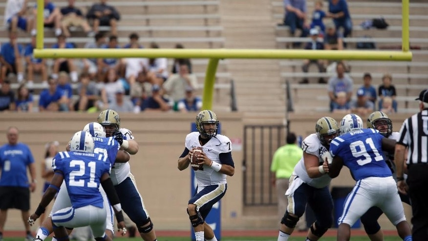 FILE - In this Sept. 21, 2013 file photo, Pittsburgh quarterback Tom Savage (7) looks to pass against Duke during the first half of an NCAA college football game in Durham, N.C.  With the competition for the entertainment dollar so tough and empty seats painting a negative image of football programs, Atlantic Coast Conference schools are brainstorming ways to get more fans to games, Wednesday, Sept. 10, 2014 (AP Photo/Gerry Broome, File)
