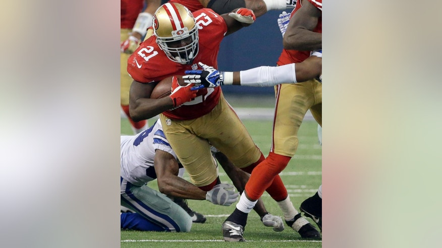 In this Sept. 7, 2014, photo, San Francisco 49ers running back Frank Gore (21) carries the ball against the Dallas Cowboys during the second half of an NFL football game in Arlington, Texas. The veteran San Francisco running back reached yet another milestone in Week 1, becoming the 29th player in NFL history to run for 10,000 yards. (AP Photo/LM Otero)