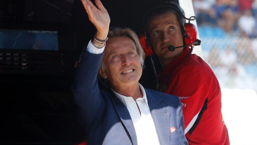 Luca Cordero di Montezemolo wawes to supporters at the pit lane during the third free practice at the Monza racetrack, in Monza, Italy , Saturday, Sept. 6 , 2014. The Formula one race will be held on Sunday. (AP Photo/Alessandro Trovati)