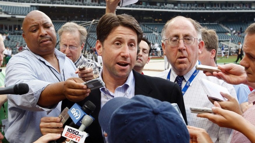 FILE: Jeff Wilpon speaks to members of the media on the field before the Mets' game against the Colorado Rockies at Citi Field in New York.