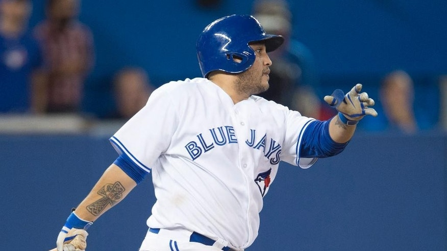 Toronto Blue Jays' Dioner Navarro watches his two-run single in the seventh inning of a baseball game against the Chicago Cubs in Toronto on Wednesday, Sept. 10, 2014. (AP Photo/The Canadian Press, Darren Calabrese)