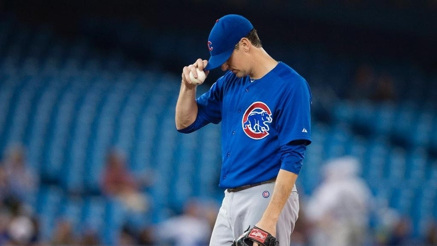 Chicago Cubs starting pitcher Kyle Hendricks waits on the mound for manager Rick Renteria to pull him from the baseball game against the Toronto Raptors in the sixth inning Wednesday, Sept. 10, 2014, in Toronto. (AP Photo/The Canadian Press, Darren Calabrese)
