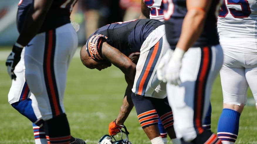 Chicago Bears wide receiver Brandon Marshall (15) pauses after a play during the second half of an NFL football game against the Buffalo Bills Sunday, Sept. 7, 2014, in Chicago. (AP Photo/Charles Rex Arbogast)
