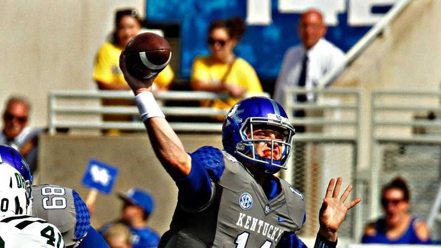 Kentucky quarterback Patrick Towles (14) makes a pass attempt against Ohio in the first half of their NCAA college football game in Lexington, Ky., Saturday Sept. 6, 2014. (AP Photo/Garry Jones)