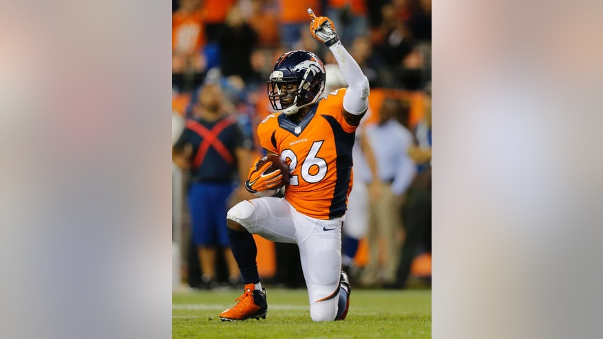 Denver Broncos free safety Rahim Moore (26) celebrates his interception against the Indianapolis Colts during the second half of an NFL football game, Sunday, Sept. 7, 2014, in Denver. (AP Photo/Jack Dempsey)