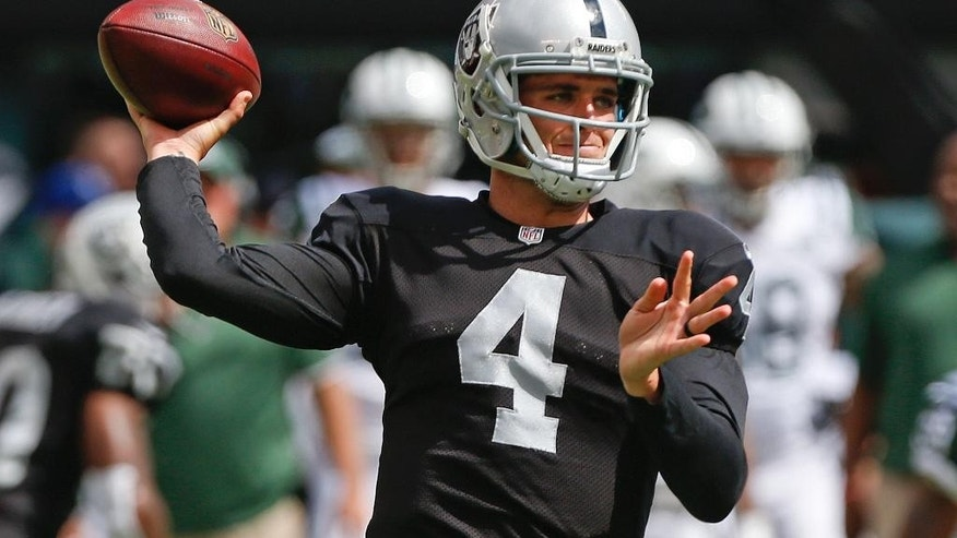 Oakland Raiders quarterback Derek Carr (4) throws a pass during the first half of an NFL football game against the New York Jets Sunday, Sept. 7, 2014, in East Rutherford, N.J. (AP Photo/Seth Wenig)