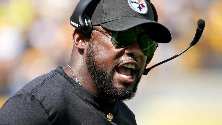 Pittsburgh Steelers head coach Mike Tomlin yells to his team in the second quarter of an NFL football game against the Cleveland Browns, Sunday, Sept. 7, 2014, in Pittsburgh. (AP Photo/Gene J. Puskar)