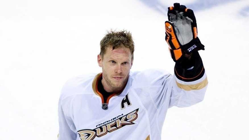 FILE - In this Jan. 22, 2011, file photo, Anaheim Ducks' Saku Koivu, of Finland, waves to the crowd following an NHL hockey game against the Montreal Canadiens in Montreal. The NHL players association announced on Wednesday, Sept. 10, 2014,  that the Finnish star would call it a career after 18 seasons, all but five of which were spent in Montreal. He won four Olympic medals with Finland in the Winter Olympics, including a silver in their 2006 loss to archrival Sweden in the final. (AP Photo/The Canadian Press, Graham Hughes, File)