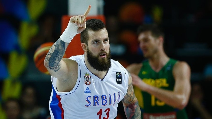 Serbia's Miroslav Raduljica celebrates during the Basketball World Cup quarterfinal between Brazil and Serbia in Madrid, Spain, Wednesday, Sept. 10, 2014. The 2014 Basketball World Cup competition will take place in various cities in Spain from Aug. 30 through to Sept. 14. (AP Photo/Andres Kudacki)