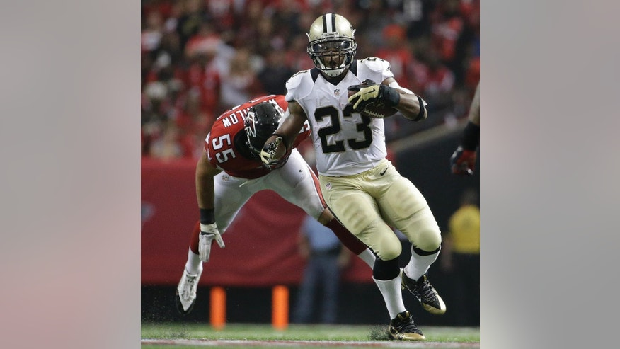 New Orleans Saints running back Pierre Thomas (23) moves against Atlanta Falcons outside linebacker Paul Worrilow (55) during the second half of an NFL football game, Sunday, Sept. 7, 2014, in Atlanta. (AP Photo/David Goldman)